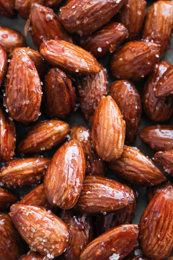 honey roasted almonds on baking paper.