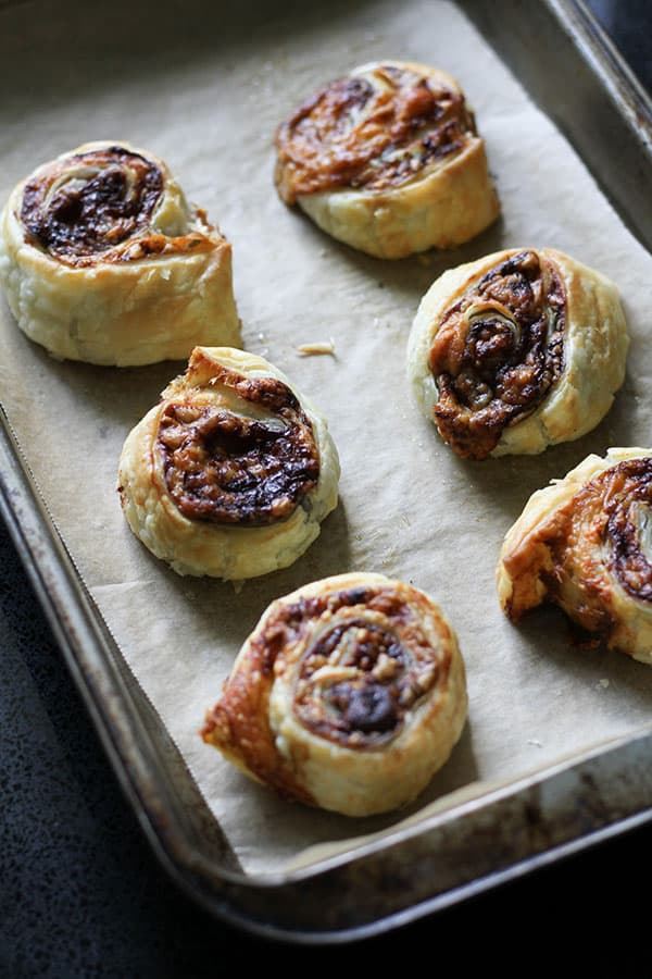 vegemite and cheese pinwheels on a baking tray.