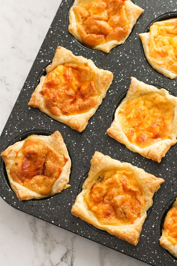 egg and bacon mini pies in a muffin tray.