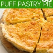 """pie sliced on a wooden board with text overlay """"bacon & egg puff pastry pie""""."""