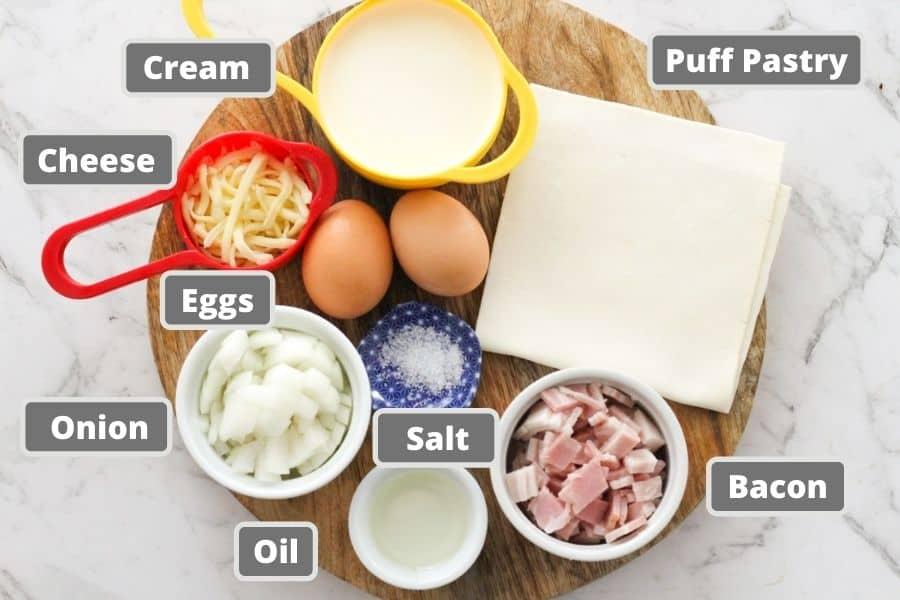 bacon egg pie ingredients on a wooden board.