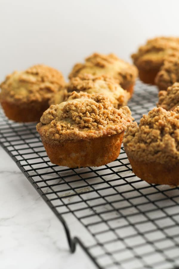 cinnamon muffins on a cooling rack.