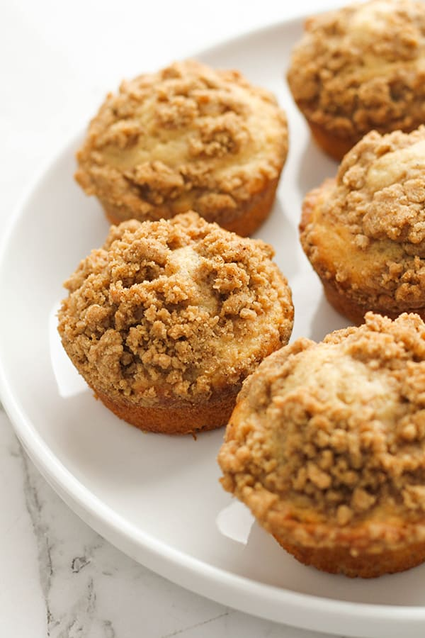 cinnamon muffins on a white plate.