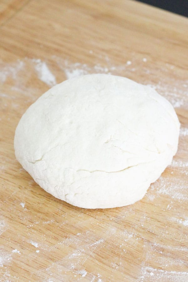 two ingredient dough on a wooden board.