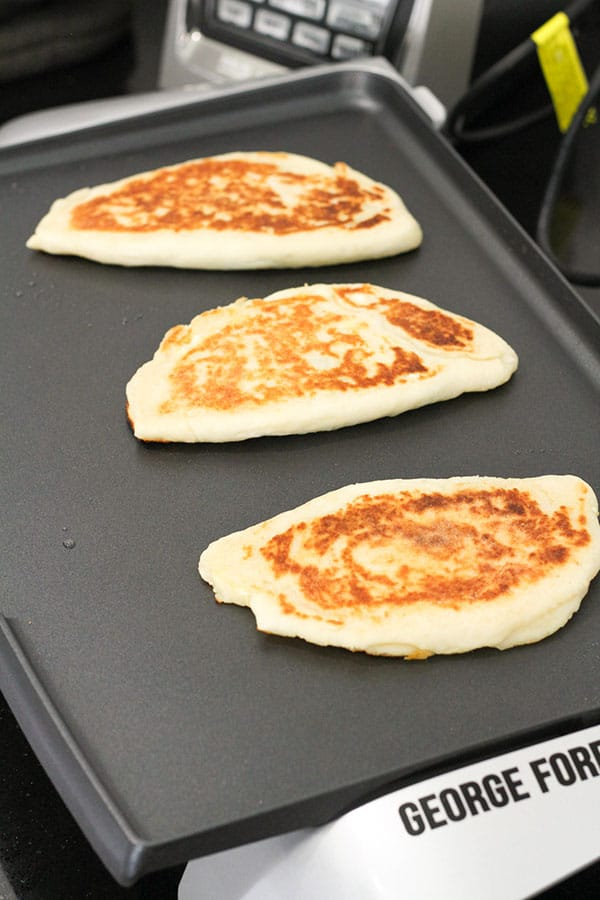 gozleme cooking on an electric griddle.