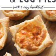 """pies on a wooden board with text overlay """"mini bacon & egg pies""""."""