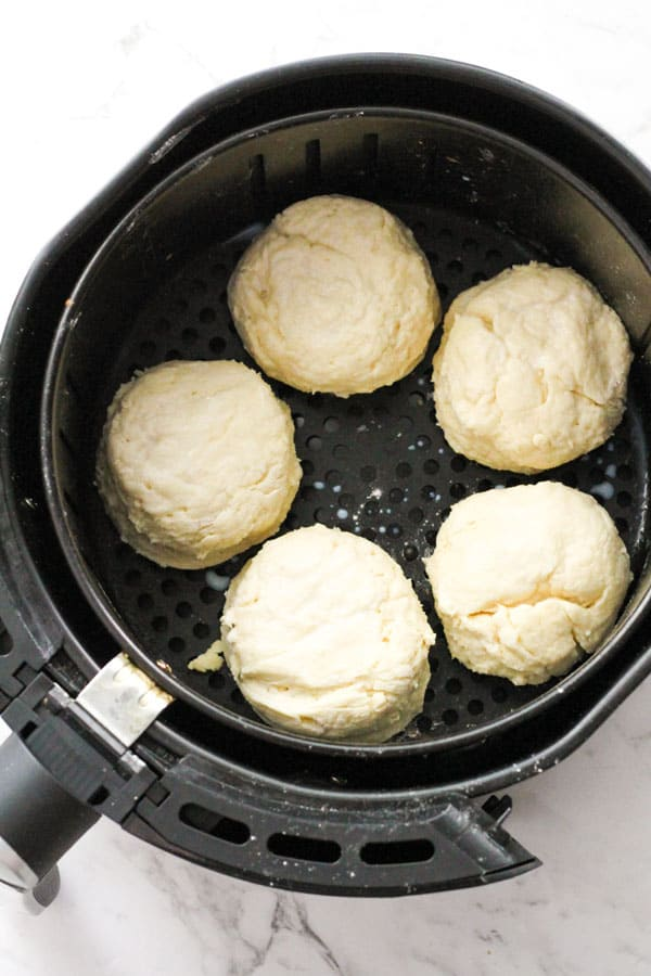 scones in the air fryer basket ready to be cooked.