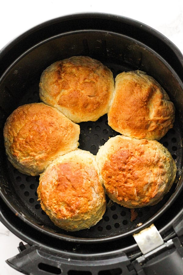 freshly baked scones in the air fryer basket.