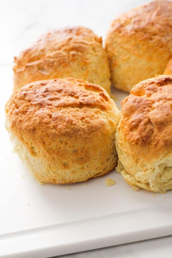 scones on a white cutting board.