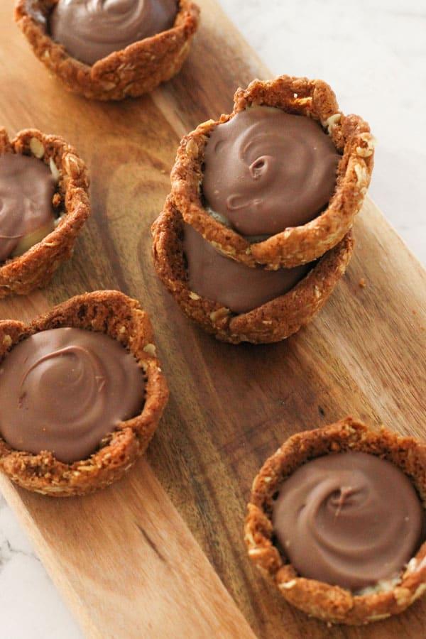 caramel tarts on a wooden board.