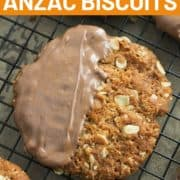 """biscuits on a wire rack with text overlay """"chocolate anzac biscuits""""."""