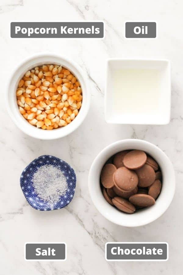 chocolate popcorn ingredients including popcorn kernels and chocolate.