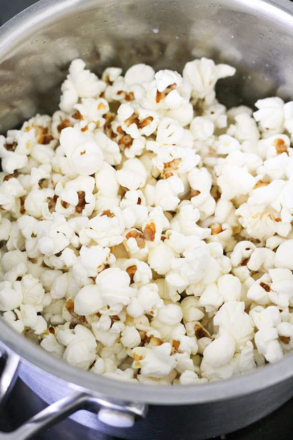 freshly popped popcorn in a saucepan.